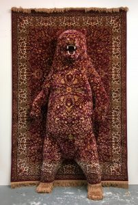 Red-Bear- emerges from rug