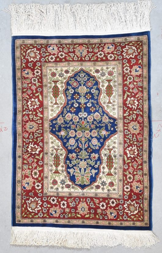 miniature silk hereke rug